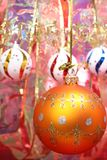 Orange christmas sphere and celebratory ribbon 2 Stock Image
