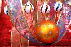 Orange christmas sphere with a pattern and celebratory ribbon 3 Royalty Free Stock Photo