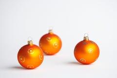 Orange Christmas Tree balls - orange Weihnachtskugeln. Three orange christmas tree balls - drei orange Weihnachtskugeln stock photo