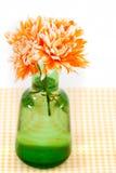 Orange chrysanthemums in a green vase Stock Photo