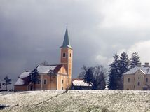 Orange church. Old classic rural church buiding in the winter time Royalty Free Stock Images