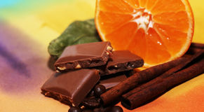 Orange and cinnamon, chocolates, food, xmas Stock Photos