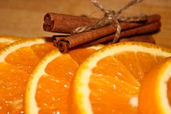 Orange with cinnamon close up royalty free stock photography