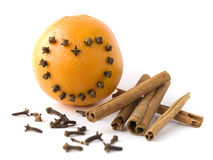 Orange and cinnamon and cloves Royalty Free Stock Photography