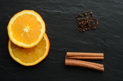 Orange, cinnamon and cloves Stock Images