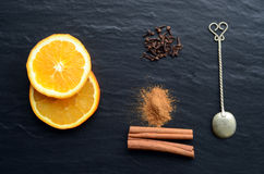 Orange, cinnamon and cloves Stock Photos