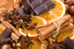 Orange with cinnamon sticks. Sliced dried orange with cinnamon sticks chocolate and anise Royalty Free Stock Photos