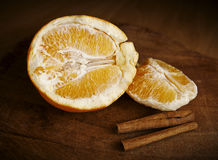 Orange and Cinnamon Sticks Royalty Free Stock Photography