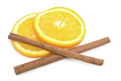 Orange and cinnamon sticks isolated on white Royalty Free Stock Photo