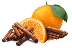 Orange with cinnamon sticks, paths. Whole and quarter of orange next to piles of cinnamon, in sticks and ground. Clipping paths, shadow separated Stock Photos
