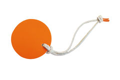 Orange circle leather price tag with leather cord isolated on wh Royalty Free Stock Images