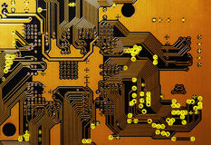 Orange Circuit Board. Circuit board from an electronic device lite up from behind Royalty Free Stock Photography