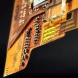 Orange circuit board Stock Images