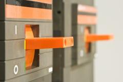 Orange circuit breaker on control panel Stock Photos