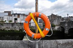 Orange city life rescue buoy stock photos