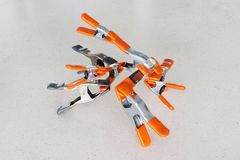 Clamps holding each other. Orange Clamps holding each other Stock Photos