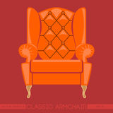 Orange classic armchair over red background Royalty Free Stock Photo
