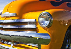 Orange Classic Car. Old classic car with orange flames royalty free stock image