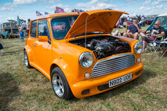 Orange Classic Mini with the bonnet open. Royalty Free Stock Photos