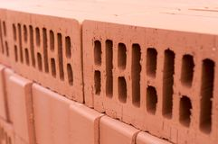 Orange clay brick stack. texture, background. Stock Photography