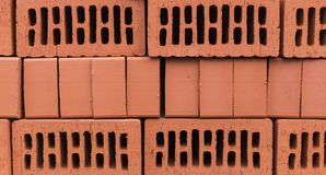 Orange clay brick stack. texture, background. Stock Images