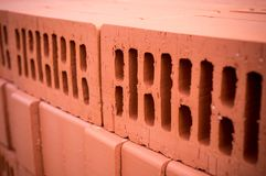 Orange clay brick stack. texture, background. Royalty Free Stock Image