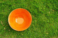 Orange  clay pottery plate at the fair of artisans in Riga Royalty Free Stock Images