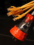 Orange and clear industrial 240V power and several yellow data plugs Stock Photo