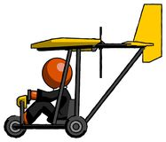 Orange Clergy Man in ultralight aircraft side view royalty free stock photos