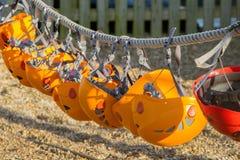 Orange climbing helmets Stock Image