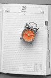 Orange clock Stock Images