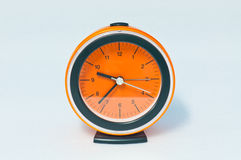 Orange clock on white screen Royalty Free Stock Photo