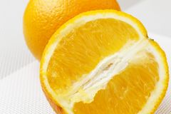 Orange close-up on a white background. Orange close-up on a white background Stock Images