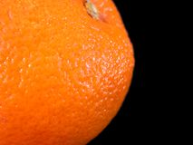 Orange Closeup. Closeup of an orange on a pure black background - room for advertising copy on this one royalty free stock photography