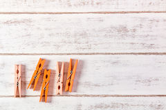Orange clothes peg on wooden table. Orange clothes peg on wooden table royalty free stock images