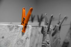 Orange Clothespin - Creative Advertising Washing Powder Or Washing Machine! Royalty Free Stock Photos