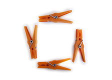 Orange clothespins. Stock orange clothespins, forming a square on a white background Royalty Free Stock Photos