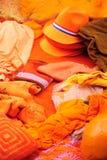 Orange clothing display at Amsterdam street market Stock Photos