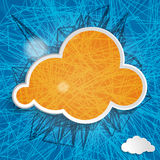 Orange cloud on a blue background Stock Images