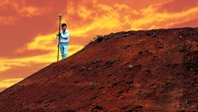 Orange cloud and red soil Royalty Free Stock Image