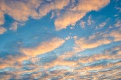 Orange clouds background, blue sky at sunset. Orange clouds background and blue sky at sunset Stock Photo