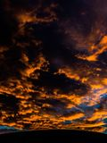 Orange clouds. Clouds being covered by the beautiful  sunset Royalty Free Stock Photos