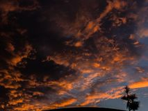 Orange clouds. Clouds being covered by the beautiful  sunset Royalty Free Stock Image