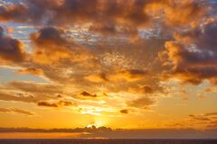 Free Orange Clouds In The Sky Above The Atlantic Ocean At Sunset Royalty Free Stock Image - 171863296