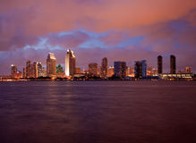 Orange clouds reflect light from San Diego Skyline. Sunset on San Diego skyline with city lights reflected in clouds taken from Coronado Stock Photography