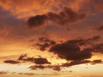 Orange clouds in sky. Royalty Free Stock Image