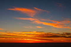 Orange clouds in the sky. Sunset in the blue sky with orange clouds royalty free stock photos