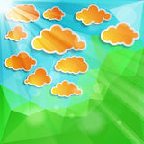 Orange clouds with sun light on a natural green background Stock Image