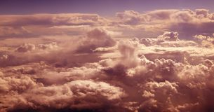 Orange cloudy sky aerial view from aircraft Royalty Free Stock Image
