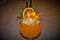Orange cobbler. Tryng a mixology refreshing cocktail royalty free stock photos